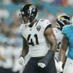 Jaguars' defensive end Josh Allen squishes the...