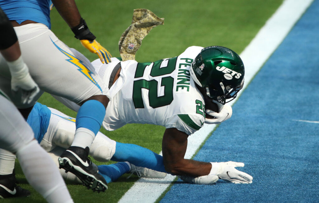 Jets rookie La'Mical Perine and Sam Ficken placed...
