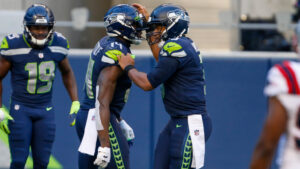 DK Metcalf says Russell Wilson talks to him like a...