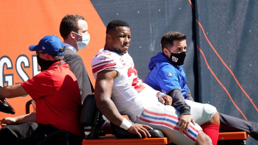 New York Giants' Saquon Barkley rehabs ACL,...