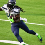 Seahawks re-sign running back Alex Collins, per...