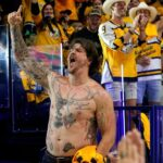 Titans' Taylor Lewan becomes ultimate hype man for...