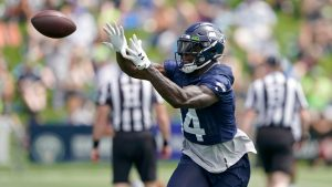 D.K. Metcalf works with Seahawks defensive line...